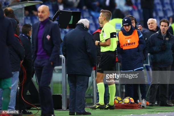 Referee Massa looking at monitor using the Var system before sanctioning the penalty during the Italian Serie A football match Lazio vs Fiorentina at...