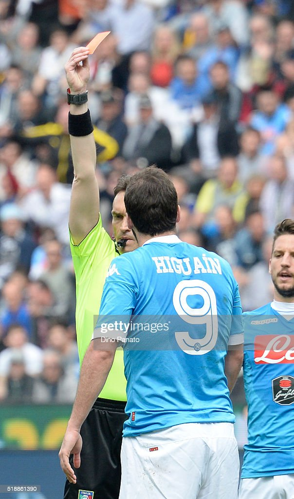 Referee Massimiliano Irrati (L) shows red card to Gonzalo Higuain of Napoli during the Serie A match between Udinese Calcio and SSC Napoli at Stadio San Paolo on April 3, 2016 in Naples, Italy.