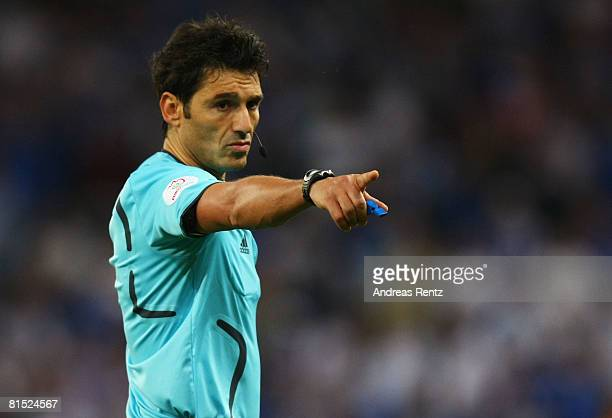 Referee Massimo Busacca gestures during the UEFA EURO 2008 Group D match between Greece and Sweden at Stadion WalsSiezenheim on June 10 2008 in...