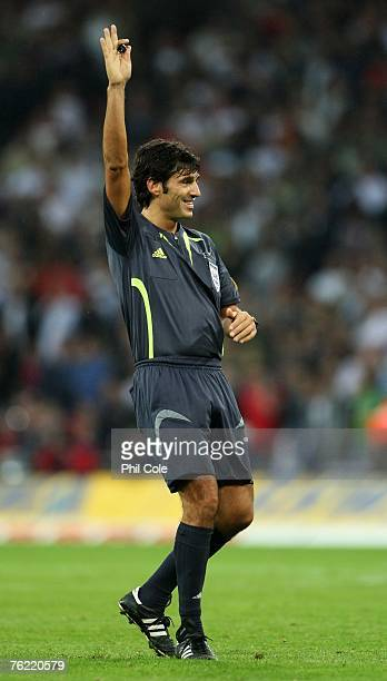 Referee Massimo Busacca of Switzerland gives a decision during the international friendly match between England and Germany at Wembley stadium on...