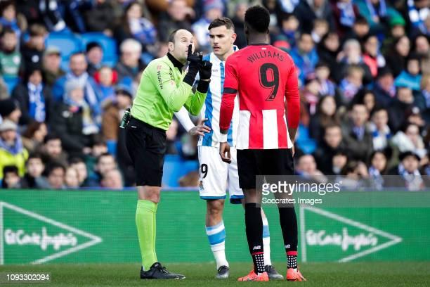 referee Mateu Lahoz Theo Hernandez of Real Sociedad Inaki Williams of Athletic Bilbao during the La Liga Santander match between Real Sociedad v...