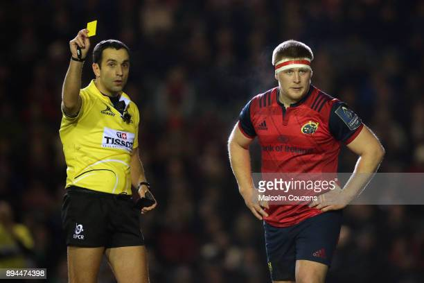 Referee Mathieu Raynal issues a yellow card to Munster prop John Ryan during the European Rugby Champions Cup match between Leicester Tigers and...