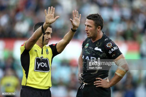 Referee Matt Cecchin sends Sam Burgess of the Rabbitohs to the sin bin during the round 17 NRL match between the South Sydney Rabbitohs and the...