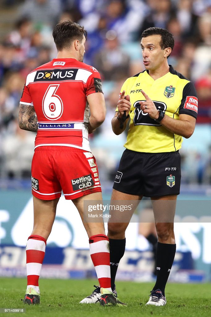 Referee Matt Cecchin speaks to Gareth Widdop of the Dragons during the round 14 NRL match between the Canterbury Bulldogs and the St George Illawarra Dragons at ANZ Stadium on June 11, 2018 in Sydney, Australia.