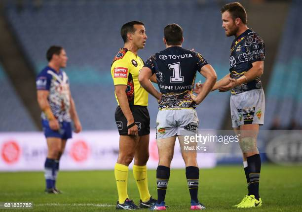 Referee Matt Cecchin talks to Lachlan Coote of the Cowboys and Gavin Cooper captain of the Cowboys during the round 10 NRL match between the...