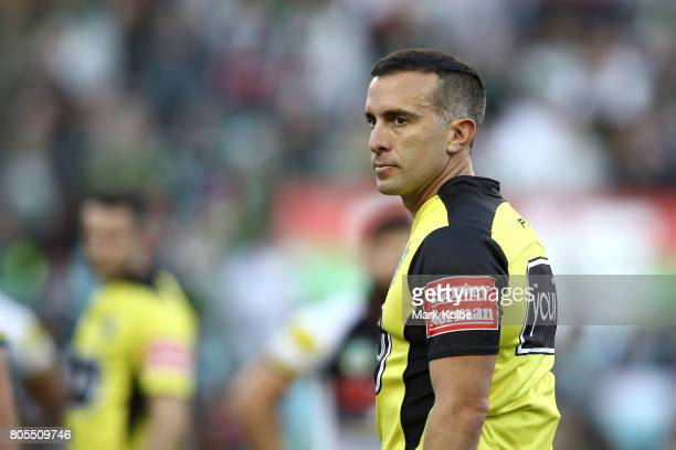 Referee Matt Cecchin watches on during the round 17 NRL match between the South Sydney Rabbitohs and the Penrith Panthers at ANZ Stadium on July 2...