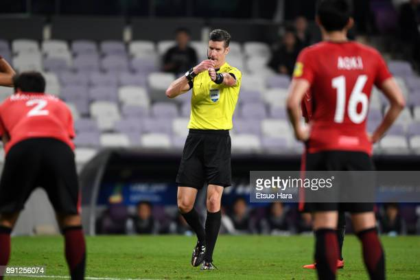 Referee Matt Conger of New Zealand points the spot to award a penalty kick to Wydad Casablanca during the FIFA Club World Cup UAE 2017 Match for 5th...
