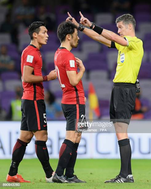 Referee Matt Conger speaks to Yuki Abe of Urawa Reds in action during the FIFA Club World Cup UAE 2017 fifth place playoff match between Wydad...