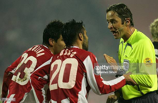 Referee Matteo Trefoloni argues with Mauricio Molina and Lukas da Silva of Belgrade during the UEFA Cup group F match between Crvena Zvezda and...