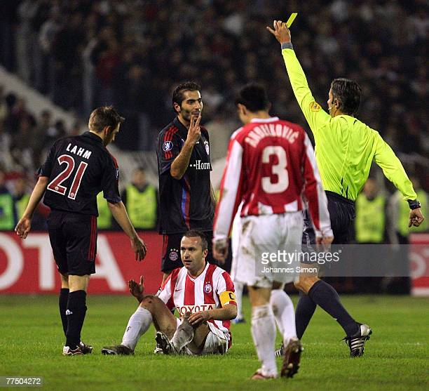 Referee Matteo Trefoloni shows the yellow card to Hamit Altintop of Bayern during the UEFA Cup group F match between Crvena Zvezda and Bayern Munich...