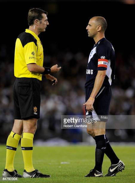 Referee Matthew Breeze talks to Victory captain Kevin Muscat during the ALeague major semi final second leg match between the Melbourne Victory and...