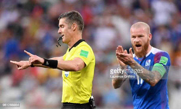 Referee Matthew Conger announces a VAR review during the 2018 FIFA World Cup Russia group D match between Nigeria and Iceland at Volgograd Arena on...