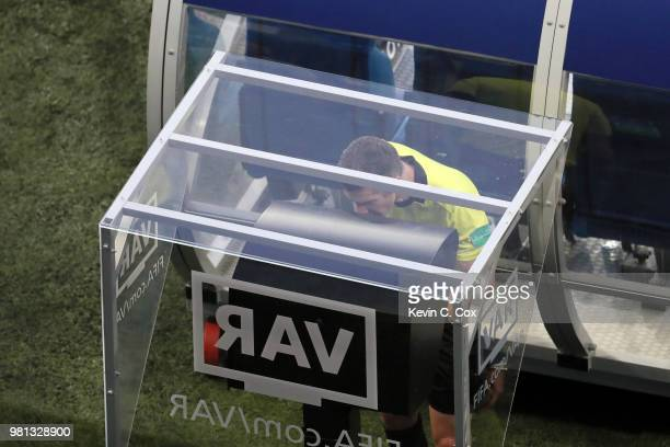 Referee Matthew Conger reviews the VAR footage before awarding Iceland a penalty during the 2018 FIFA World Cup Russia group D match between Nigeria...