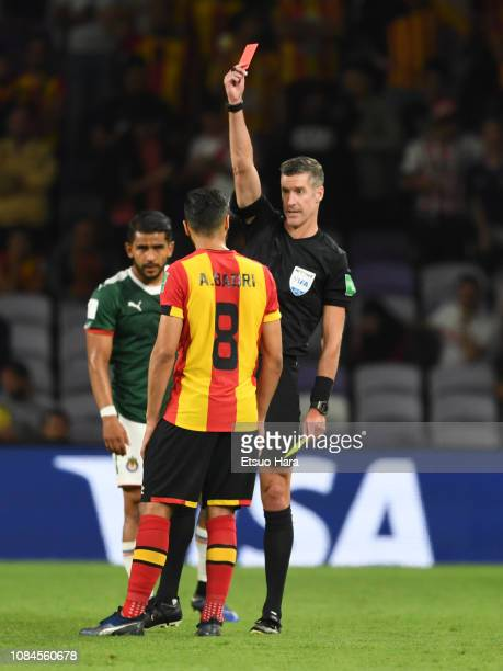 Referee Matthew Conger shows a red card to Anice Badri of Tunis during the match between ES Tunis and CD Guadalajara on December 18 2018 in Al Ain...