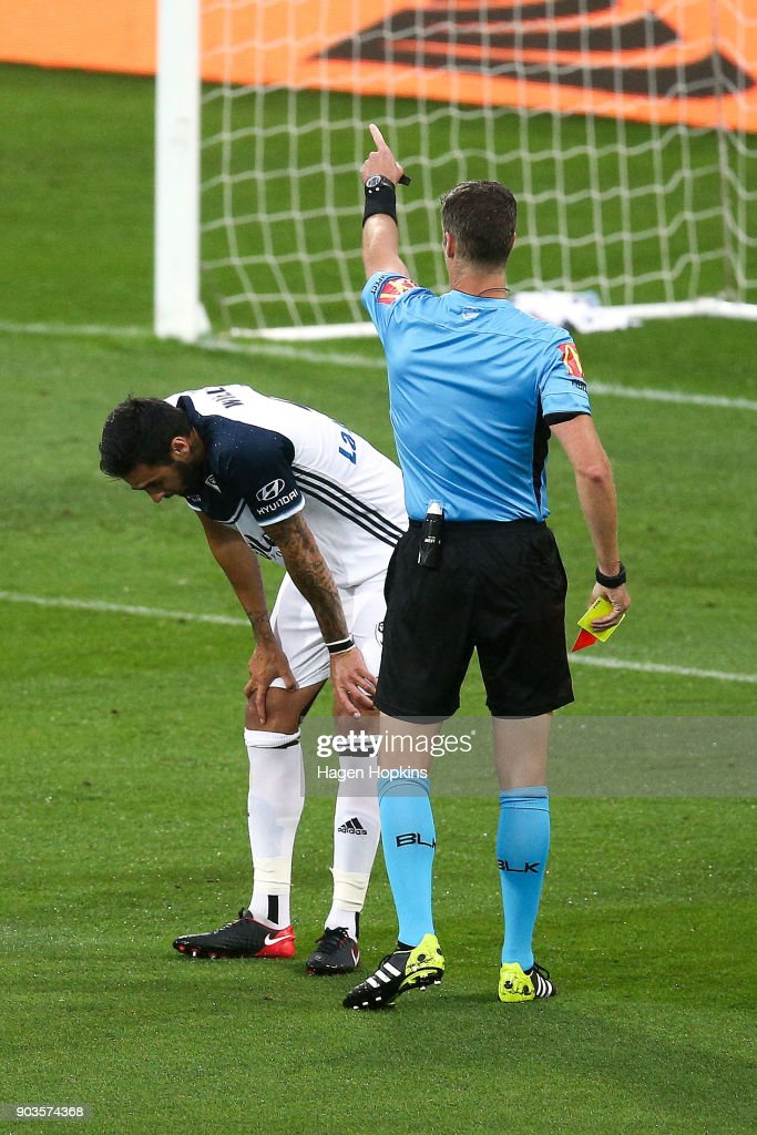 Referee Matthew Conger shows a red card to Rhys Williams of the Victory during the round 15 A-League match between the Wellington Phoenix and Melbourne Victory at Westpac Stadium on January 10, 2018 in Wellington, New Zealand.