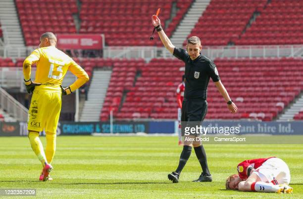 Referee Matthew Donohue shows Queens Park Rangers' Seny Dieng a straight red for a foul on Middlesbrough's Duncan Watmore during the Sky Bet...