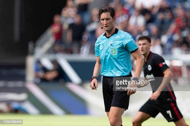 Referee Matthias Joellenbeck looks on during the Bundesliga match between Eintracht Frankfurt and VfB Stuttgart at Deutsche Bank Park on September...
