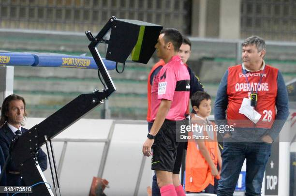 Referee Maurizio Mariani looks VAR during the Serie A match between AC Chievo Verona and Atalanta BC at Stadio Marc'Antonio Bentegodi on September 17...