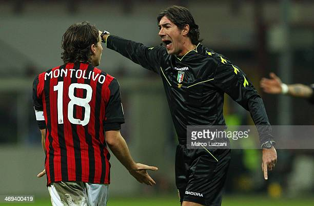 Referee Mauro Bergonzi disputes with Riccardo Montolivo of AC Milan during the Serie A match between AC Milan and Bologna FC at San Siro Stadium on...
