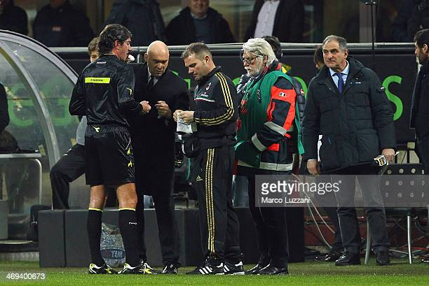 Referee Mauro Bergonzi receives medical care during the Serie A match between AC Milan and Bologna FC at San Siro Stadium on February 14 2014 in...