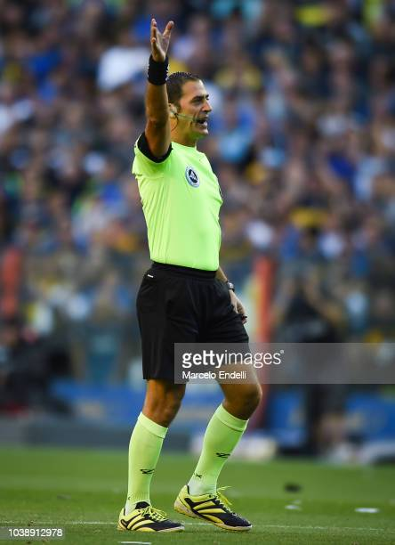 Referee Mauro Vigliano gestures during a match between Boca Juniors and River Plate as part of Superliga 2018/19 at Estadio Alberto J Armando on...