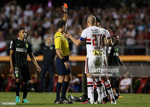 Referee Mauro Vigliano shows Maicon of Sao Paulo the red card during semifinal first leg match of Copa Bridgestone Libertadores between Sao Paulo and...