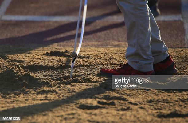 Referee Measuring the distance in a long jump pit