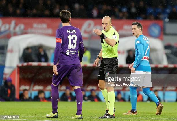 Referee Michael Fabbri with ACF Fiorentina player Davide Astori during the Serie A match between SSC Napoli and ACF Fiorentina at Stadio San Paolo on...