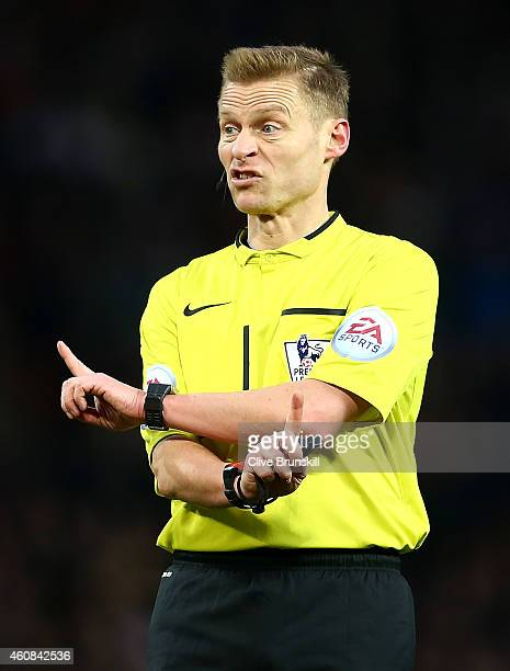 Referee Michael Jones gestures during the Barclays Premier League match between Manchester United and Newcastle United at Old Trafford on December 26...