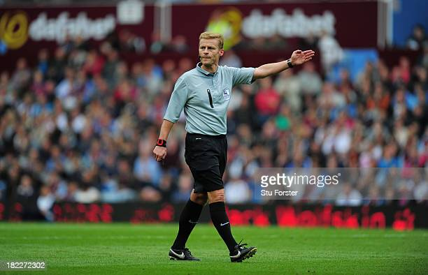 Referee Michael Jones in action during the Barclays Premier League match between Aston Villa and Manchester City at Villa Park on September 28 2013...