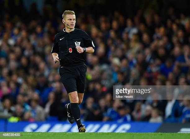 Referee Michael Jones in action during the Barclays Premier League match between Chelsea and Queens Park Rangers at Stamford Bridge on November 1...