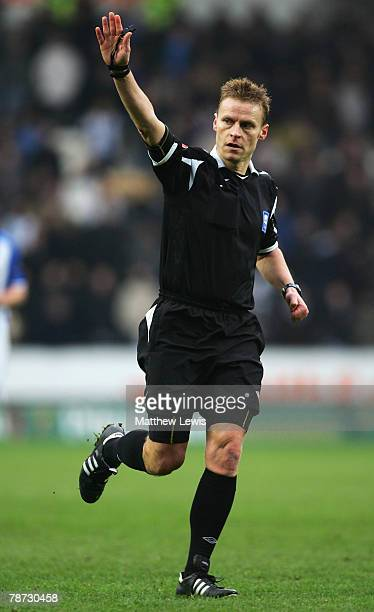Referee Michael Jones in action during the Coca-Cola Championship match between Hull City and Sheffield Wednesday at the KC Stadium on December 30,...