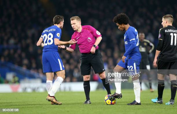 Referee Michael Jones speaks to Cesar Azpilicueta of Chelsea during the Premier League match between Chelsea and Leicester City at Stamford Bridge on...