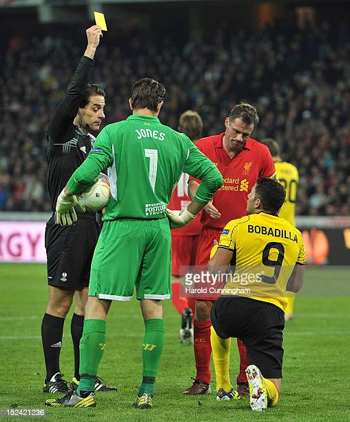 Referee Michael Koukoulakis shows a yellow to Raul Bobadilla of BSC Young Boys during the UEFA Europa League Group A match between BSC Young Boys and...
