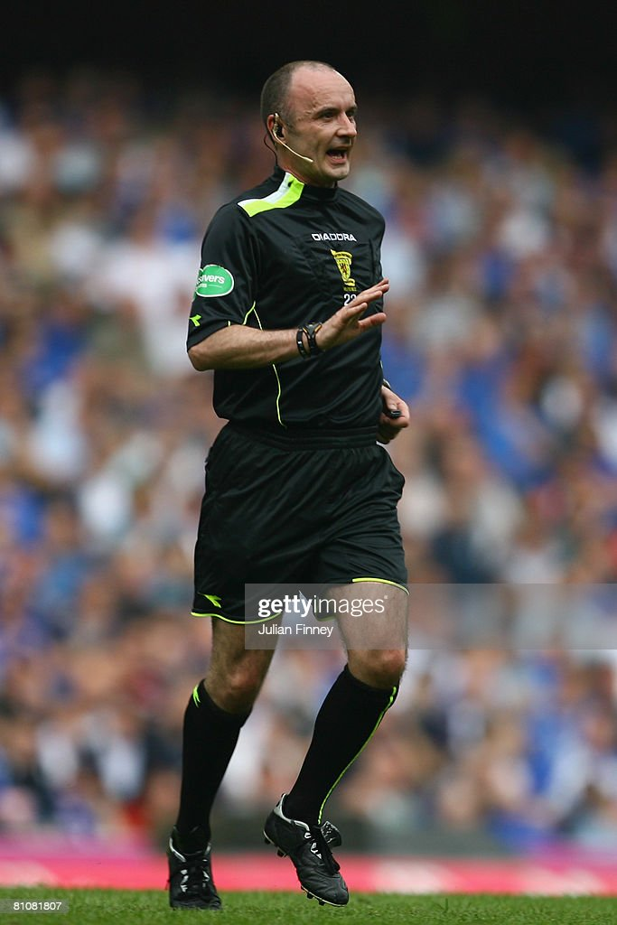 Referee, Michael McCurry gives instructions during The Clydesdale Bank Scottish Premier League match between Rangers and Dundee United at Ibrox Stadium on May 10, 2008 in Glasgow, Scotland.