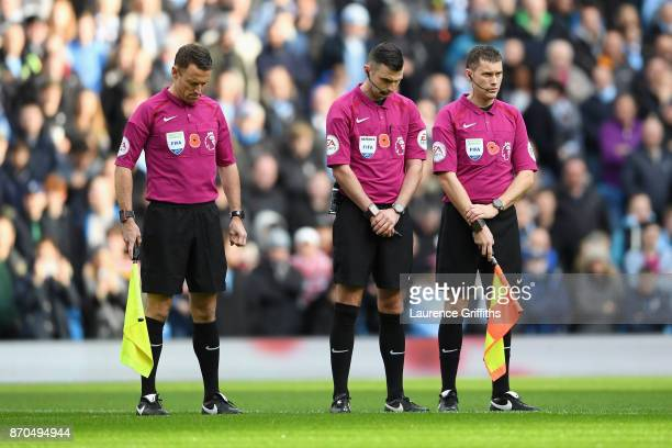 Referee Michael Oliver and his two assistants Simon Bennett and Stuart Burt take part in a minute of silence for remeberance Sunday prior to the...