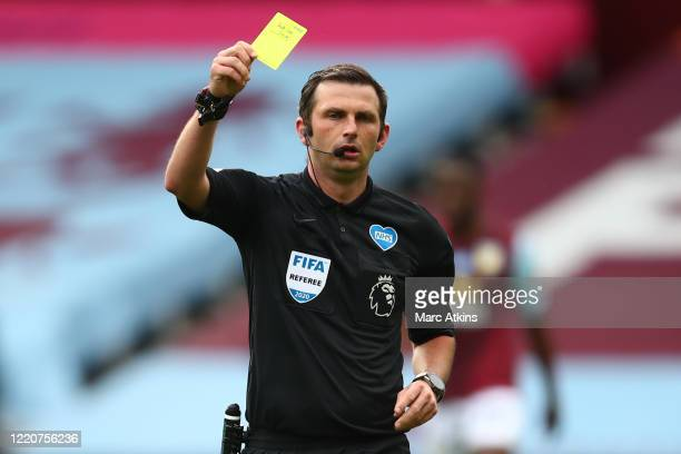 Referee Michael Oliver awards a yellow card during the Premier League match between Aston Villa and Sheffield United at Villa Park on June 17, 2020...