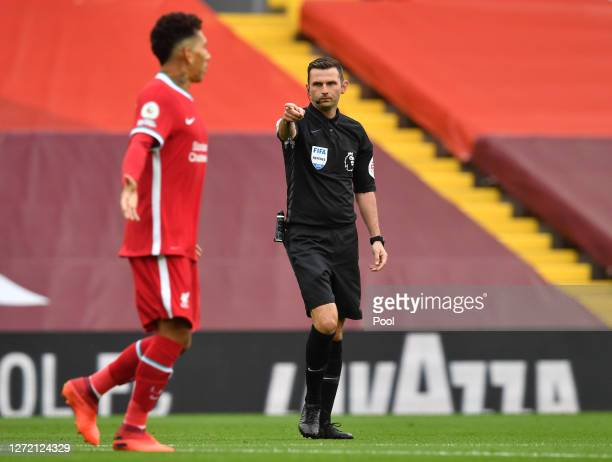 Referee Michael Oliver awards Liverpool a penalty during the Premier League match between Liverpool and Leeds United at Anfield on September 12, 2020...