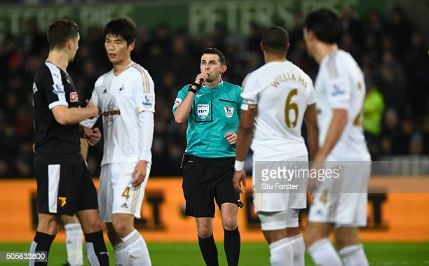 Referee Michael Oliver blows his whistle during the Barclays Premier League match between Swansea City and Watford at Liberty Stadium on January 18...