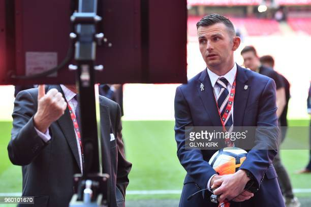 Referee Michael Oliver checks out the VAR system ahead of the English FA Cup final football match between Chelsea and Manchester United at Wembley...