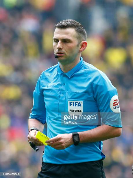 Referee Michael Oliver during The FA Emirates Cup Semi-Final match between Watford and Wolverhampton Wanderers at Wembley Stadium, London, United...
