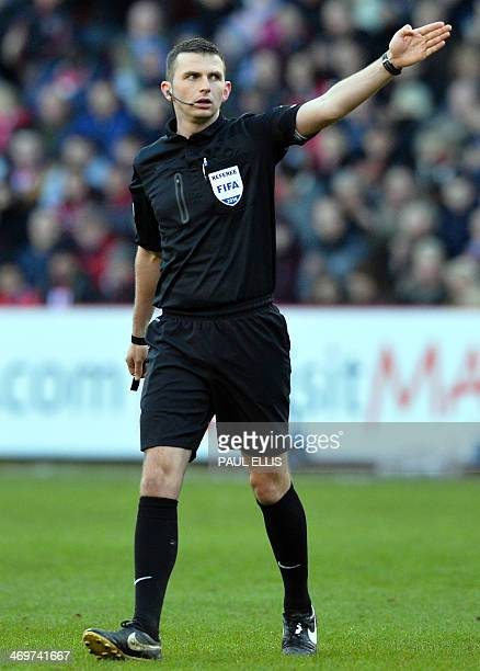 Referee Michael Oliver gestures during the English FA Cup fifth round football match between Sheffield United and Nottingham Forest at Bramall Lane...