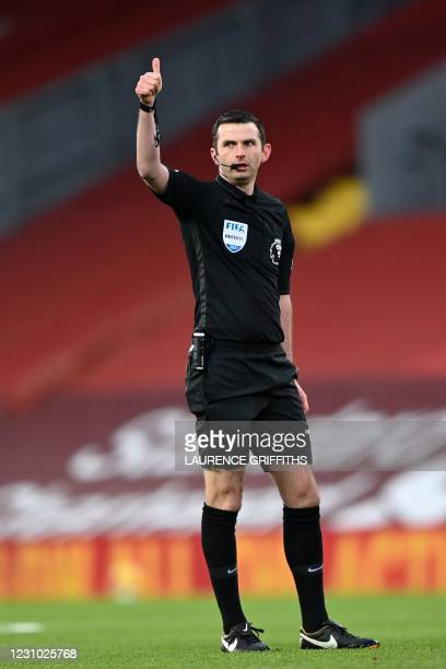 Referee Michael Oliver gestures during the English Premier League football match between Liverpool and Manchester City at Anfield in Liverpool, north...