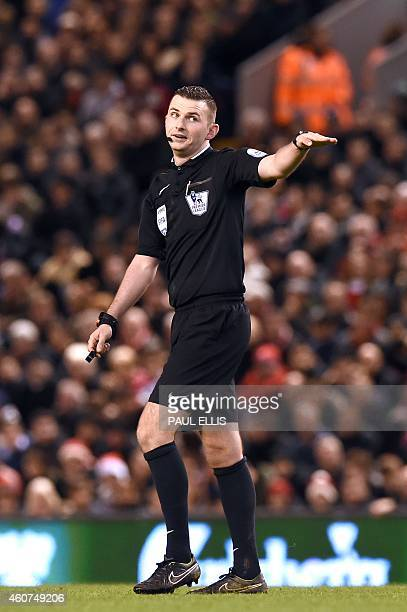 Referee Michael Oliver gestures during the English Premier League football match between Liverpool and Arsenal at Anfield in Liverpool Northwest...