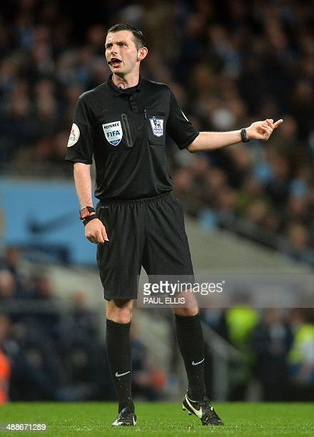 Referee Michael Oliver gestures during the English Premier League football match between Manchester City and Aston Villa at the Etihad Stadium in...