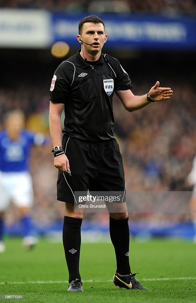 Referee Michael Oliver gestures during the FA Cup Fifth Round match between Everton and Blackpool at Goodison Park on February 18, 2012 in Liverpool, England.