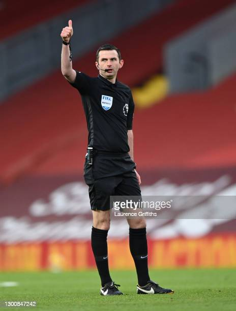 Referee, Michael Oliver gestures during the Premier League match between Liverpool and Manchester City at Anfield on February 07, 2021 in Liverpool,...