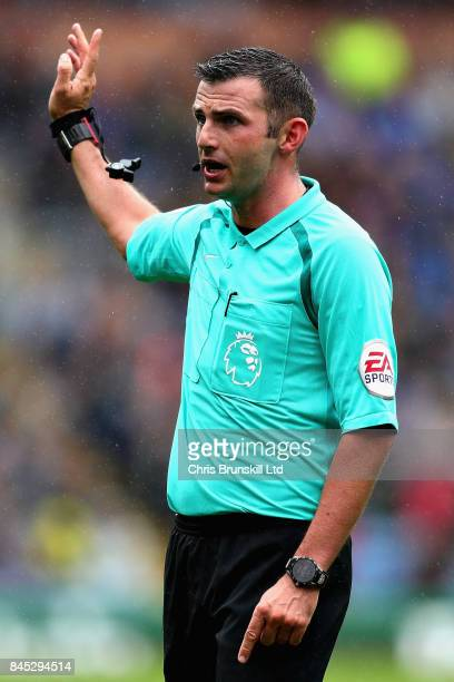 Referee Michael Oliver gestures during the Premier League match between Burnley and Crystal Palace at Turf Moor on September 10 2017 in Burnley...