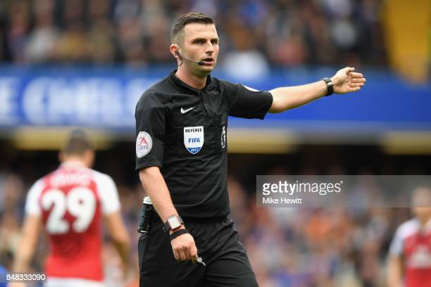 Referee Michael Oliver gestures during the Premier League match between Chelsea and Arsenal at Stamford Bridge on September 17 2017 in London England