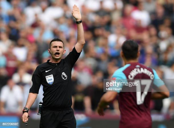 Referee Michael Oliver gestures to Javier Hernandez of West Ham United during the Premier League match between West Ham United and Tottenham Hotspur...